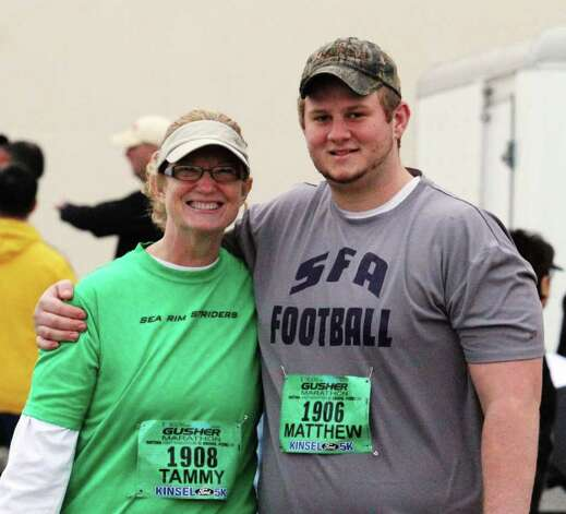 Tammy and Kirby Newby are all smiles before the start of the Gusher 5K race. Kevin Daigle/The Enterprise Photo: Kevin Daigle