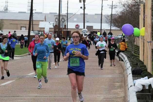 Runners participate in the Gusher Marathon, Half Marathon and 5K race in Beaumont on Saturday.  Kevin Daigle/The Enterprise Photo: Kevin Daigle