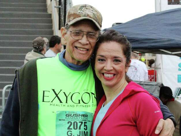 Laura Solis with father Jim Solis, 82, who was the oldest runner in the Gusher 5K.  Kevin Daigle/The Enterprise Photo: Kevin Daigle