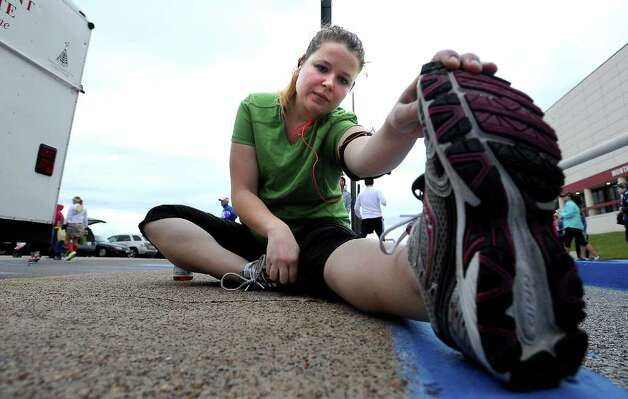 Amelia Wiggins stretches out before the Gusher Marathon in Beaumont, Saturday, March 10, 2012. Tammy McKinley/The Enterprise Photo: TAMMY MCKINLEY