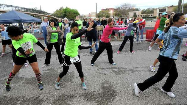 Runners warm up with a little Zumba before the Gusher Marathon in Beaumont, Saturday, March 10, 2012. Tammy McKinley/The Enterprise Photo: TAMMY MCKINLEY