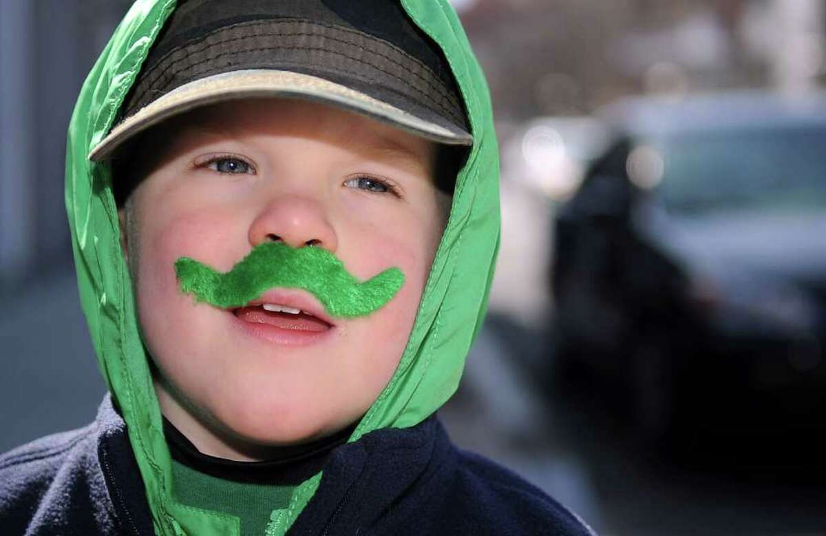 Joshua Lowry, 3, of Southbury, dons a green mustache for Saturday's Saint Patrick's Day parade in Stamford on March 10, 2012.