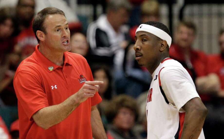 Lamar coach Pat Knight, left, yells at Devon Lamb, right, during the first half of the Southland Conference tournament championship basketball game against the McNeese State Saturday, March 10, 2012, in Katy, Texas. (AP Photo/David J. Phillip) Photo: David J. Phillip, STF / AP