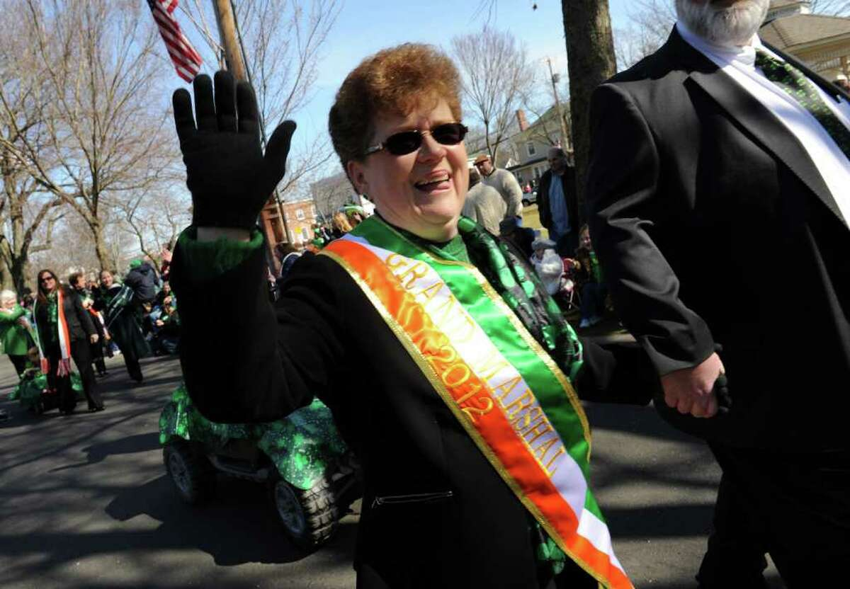 Linda Gilbert, the 2012 Grand Marshal, walks down Broad Street in the St. Patrick's Day Parade in downtown Milford, Conn. on Saturday March 10, 2012.