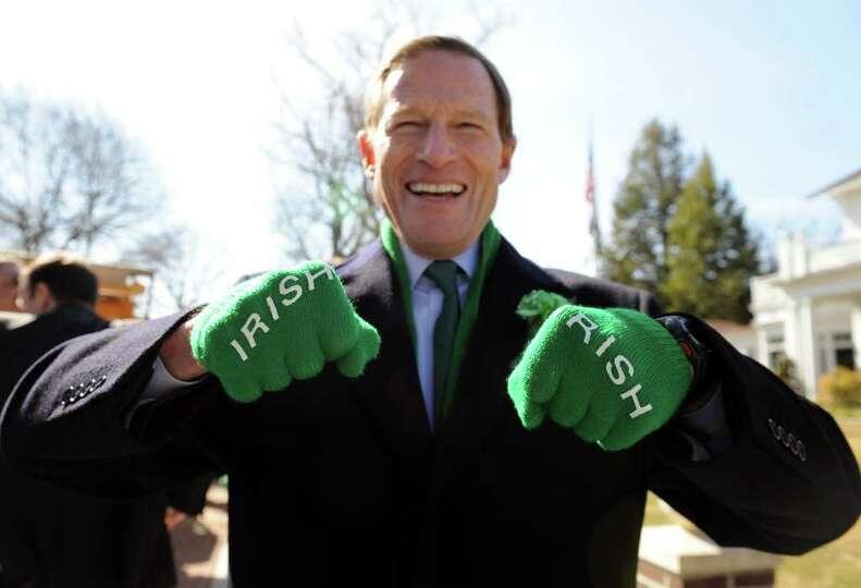 Senator Richard Blumenthal shows his Irish spirit during the St. Patrick's Day Parade in downtown Mi