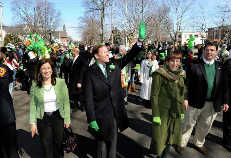 Local and state politicians take part in the St. Patrick's Day Parade in downtown Milford, Conn. on