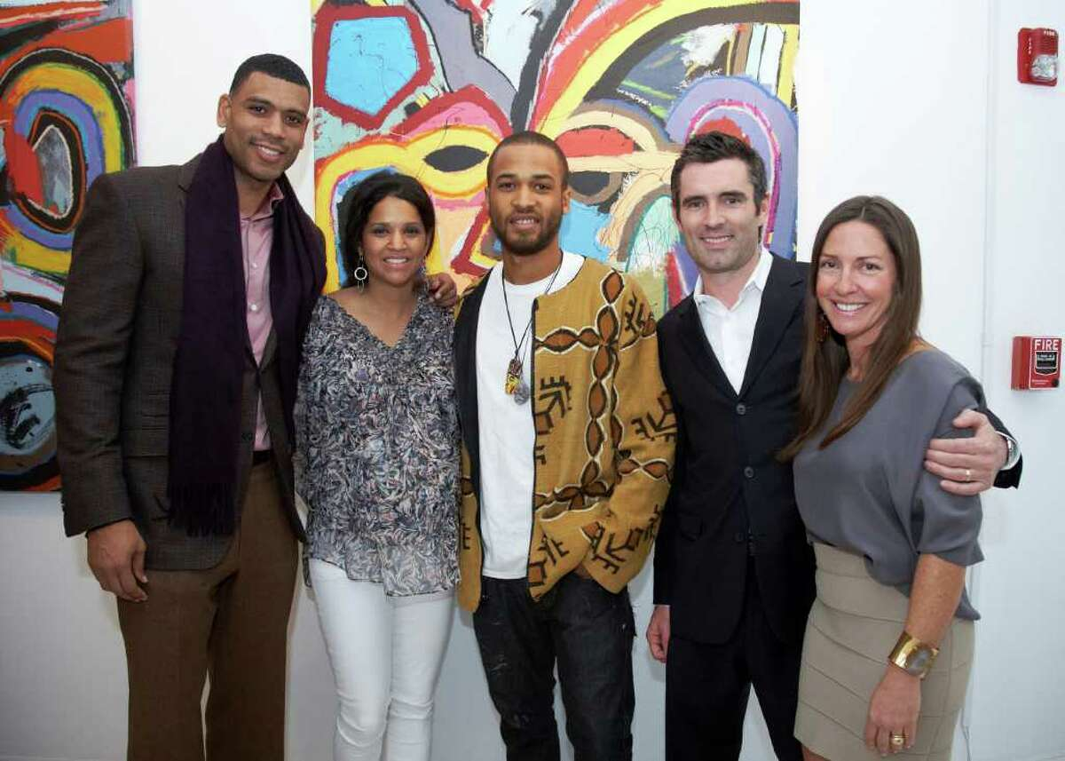 """Allan and Tamara Houston, artist Asa Jackson and gallery owners Lee and Cindy Milazzo March 1 at the opening reception for Jackson's """"New Works"""" exhibition at Samuel Owen Gallery in Greenwich."""