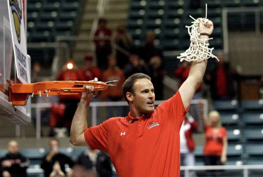 Lamar coach Pat Knight cuts down the net after winning the Southland Conference tournament championship basketball game Saturday, March 10, 2012, in Katy, Texas. Lamar beat McNeese State 70-49. (AP Photo/David J. Phillip) Photo: David J. Phillip, Associated Press / AP