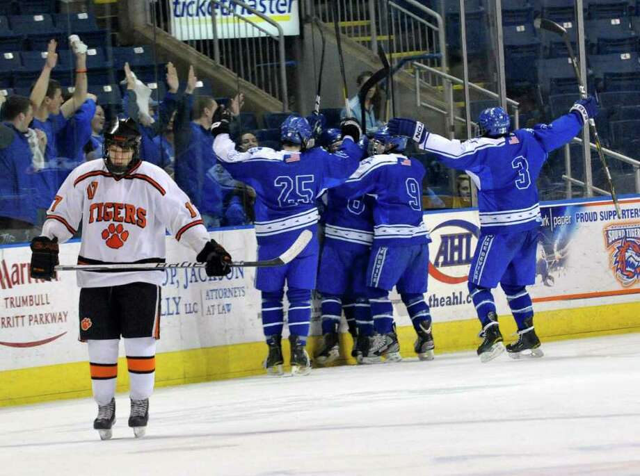 Ridgefield's John Tregurtha skates back to center ice after West Haven scored their forth goal during their Divison I quarterfinal game at Webster Bank Arena in Bridgeport on Saturday, March 10, 2012. West Haven won 4-1. Photo: Jason Rearick / The News-Times