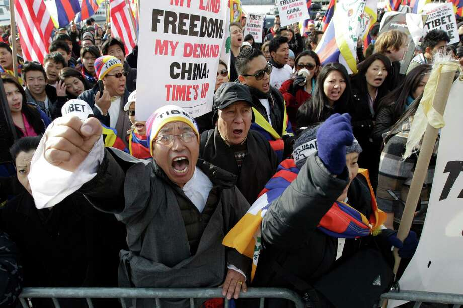 Tibetan exiles chant slogans during a rally in front of the Chinese Embassy to mark the 53rd anniversary of an uprising against Chinese rule, Saturday, March 10, 2012 in New York. Saturday marks the anniversary of a 1959 revolt in which Tibetans resisted an occupation by Chinese troops. In the past 2.5 months, 14 people have set themselves in fire in Tibet to protest Chinese rule. Photo: Mary Altaffer, AP / AP