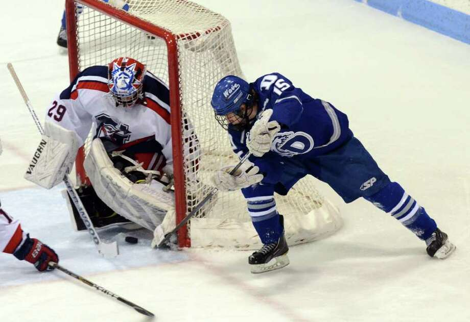 Darien's Nick Bruno (15) takes a shot on Glastonbury goalie Chase Gabor (29) but is denied during the boys hockey Division I quarterfinals at Ingalls Rink in New Haven on Saturday, Mar. 10, 2012. Photo: Amy Mortensen