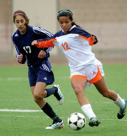 Amanda Coronado (17) of O'Connor chases as Alyssa Amaya (12) of Brandeis controls the ball during girls soccer action at Farris Stadium on Saturday, March 10, 2012. Billy Calzada / San Antonio Express-News Photo: Billy Calzada, Express-News / San Antonio Express-News