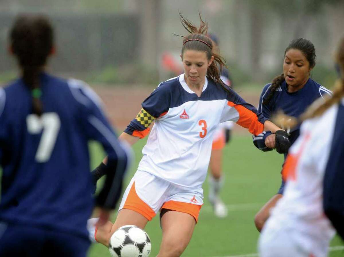 Brandeis' Lisa Tomenendal (3) works the ball against O'Connor during girls soccer action at Farris Stadium on Saturday, March 10, 2012. Billy Calzada / San Antonio Express-News