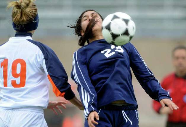Alexis Alaniz (23) of O'Connor controls the ball by Taylor Blackwell (19) of Brandeis during girls soccer action at Farris Stadium on Saturday, March 10, 2012. Billy Calzada / San Antonio Express-News Photo: Billy Calzada, Express-News / San Antonio Express-News