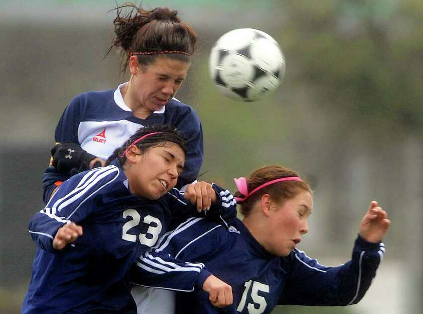 Lisa Tomenendal, top, of Brandeis, battles Alexis Alaniz (23) and Lauren McKenzie (15) of O'Connor during girls soccer action at Farris Stadium on Saturday, March 10, 2012. Billy Calzada / San Antonio Express-News