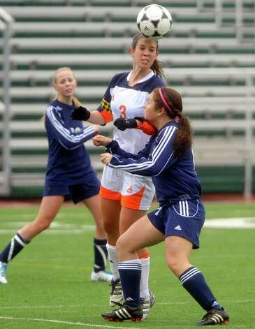 Lisa Tomenendal of Brandeis heads the ball as Lauren McKenzie of O'Connor defends during girls soccer action at Farris Stadium on Saturday, March 10, 2012. Billy Calzada / San Antonio Express-News Photo: Billy Calzada, Express-News / San Antonio Express-News
