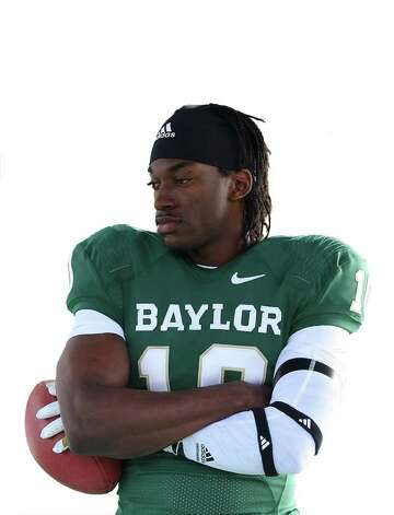 Heisman Trophy-winner and former Baylor quarterback Robert Griffin III poses for a photo on the Baylor campus, Monday, Feb. 27, 2012, in Waco, Texas, for the EA Sports NCAA Football 13 video game to be released in July. Photo: Jerry Larson, AP / Waco Tribune Herald