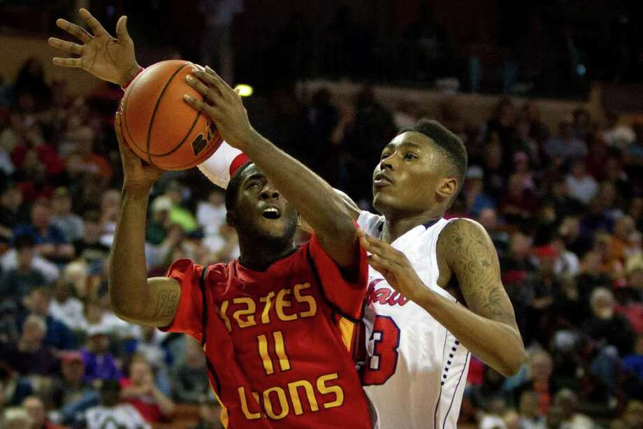 Houston Yates guard Jonah Jackson (11) puts up a shot as Dallas Kimball guard/forward D'Angelo Allen Photo: Smiley N. Pool, Houston Chronicle / © 2012  Houston Chronicle