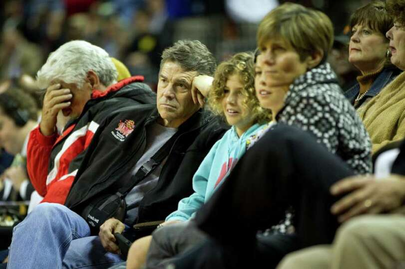 Texas Gov. Rick Perry watches Houston Yates face Dallas Kimball during the first half of the UIL cla