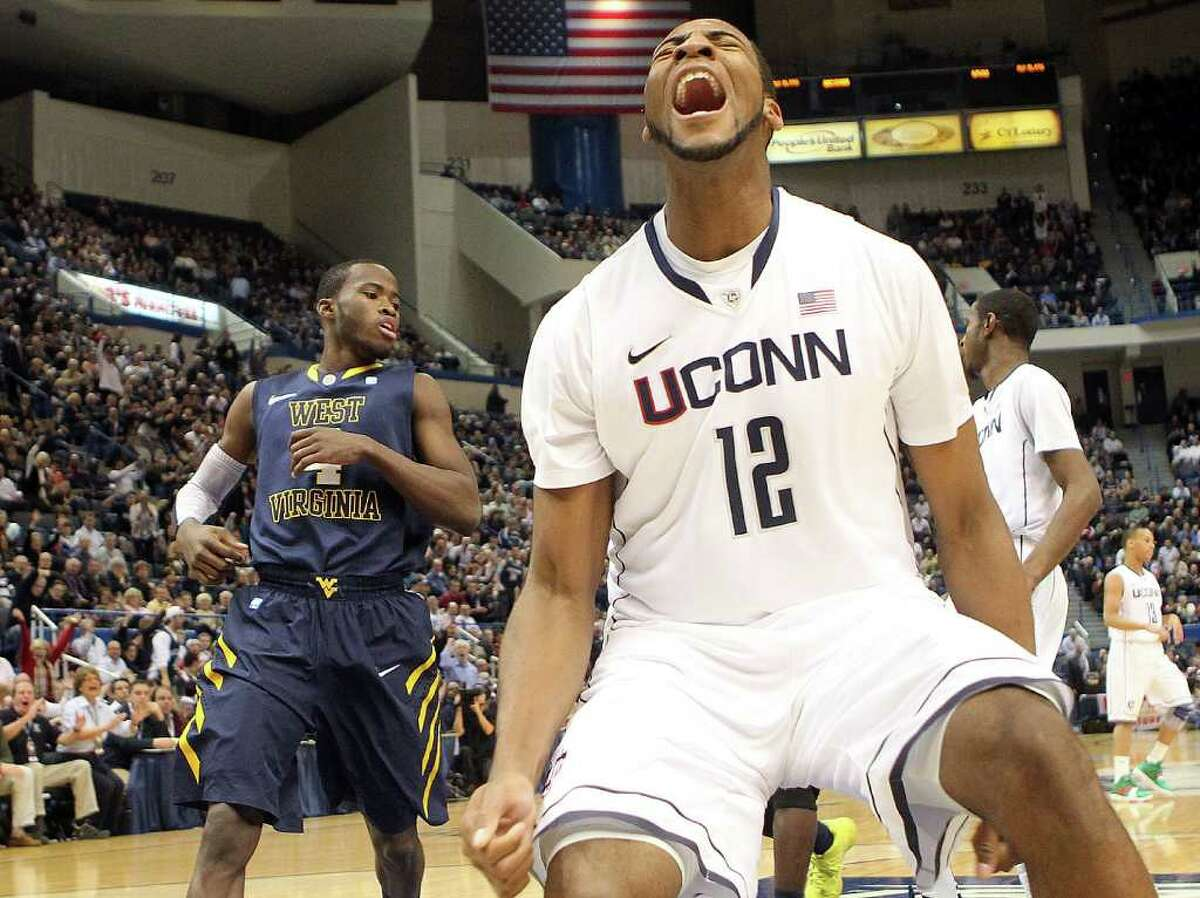 HARTFORD, CT - JANUARY 9: Andre Drummond #12 of the Connecticut Huskies reacts after scoring despite the defense of Jabarie Hinds #4 of the West Virginia Mountaineers at the XL Center on January 9, 2012 in Hartford, Connecticut. (Photo by Jim Rogash/Getty Images)