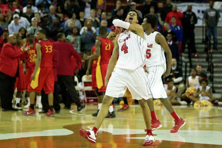 Dallas Kimball guard Keith Frazier (4) celebrates in the final moments of the Knights victory over Houston Yates during in the UIL class 4A state championship high school basketball game at the Erwin Center on Saturday, March 10, 2012, in Austin.  Kimball won the game 78-75. Photo: Smiley N. Pool, Houston Chronicle / © 2012  Houston Chronicle