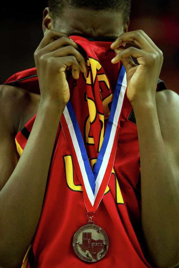 Houston Yates forward Marquez Ellis  reacts after the Lions loss to Dallas Kimball in the UIL class 4A state championship high school basketball game at the Erwin Center on Saturday, March 10, 2012, in Austin.  Kimball won the game 78-75. Photo: Smiley N. Pool, Houston Chronicle / © 2012  Houston Chronicle