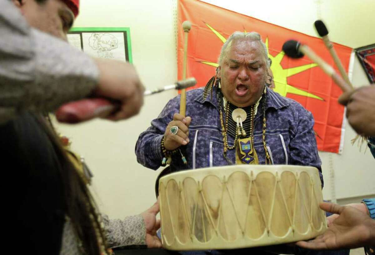 Steven Fernandez of San Antonio, left, along with Larry Running Turtle Salazar of Corpus Christi and others drum Saturday at the Southern Apache Museum.