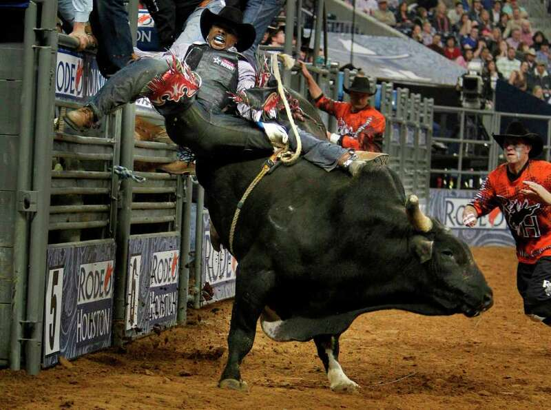 Mike Moore competes Bull Riding during the BP Super Series IV Championship at Reliant Stadium on Sat