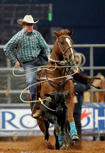 Nate Baldwin competes in Tie-Down Roping during the BP Super Series IV Championship at Reliant Stadi