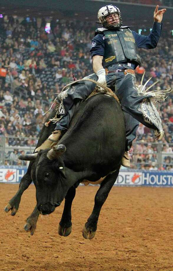 Corey Navarre competes Bull Riding during the BP Super Series IV Championship at Reliant Stadium on Saturday, March 10, 2012, in Houston. Photo: Mayra Beltran, Houston Chronicle / © 2012 Houston Chronicle