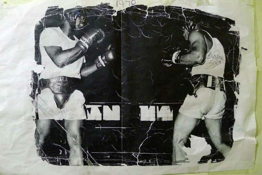 Former heavyweight boxer Joe Alexander ,right, in a 1970 photo when he sparred with Muhammad Ali. Alexander is a former heavyweight boxer whose claim to fame was knocking down Jerry Quarry in a fight in 1974.( Photo Courtesy Joe Alexander ) Photo: Michael P. Farrell / 00016528A