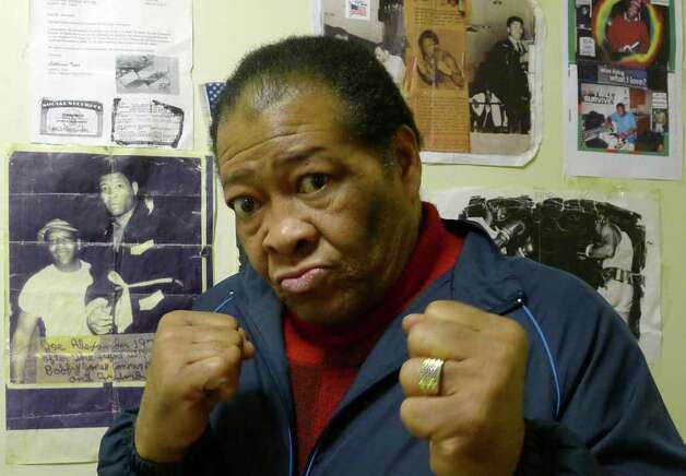 Former heavyweight boxer Joe Alexander amid clippings of his career at his home in Albany, N.Y. Saturday Feb.25, 2012. Alexander is a former heavyweight boxer whose claim to fame was knocking down Jerry Quarry in a fight in 1974.( Michael P. Farrell/Times Union) Photo: Michael P. Farrell / 00016528A