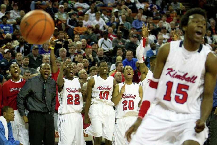 Dallas Kimball players celebrate a basket against Houston Yates during the second half of the UIL class 4A state championship high school basketball game at the Erwin Center on Saturday, March 10, 2012, in Austin.  Kimball won the game 78-75. Photo: Smiley N. Pool, Houston Chronicle / © 2012  Houston Chronicle