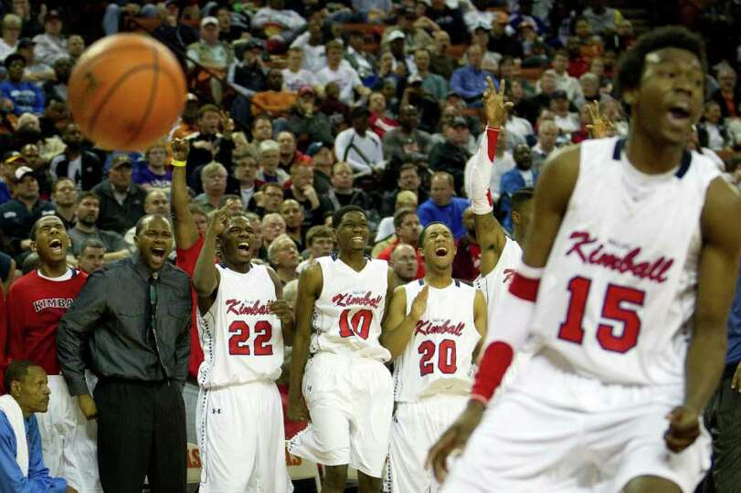 Dallas Kimball players celebrate a basket against Houston Yates during the second half of the UIL cl