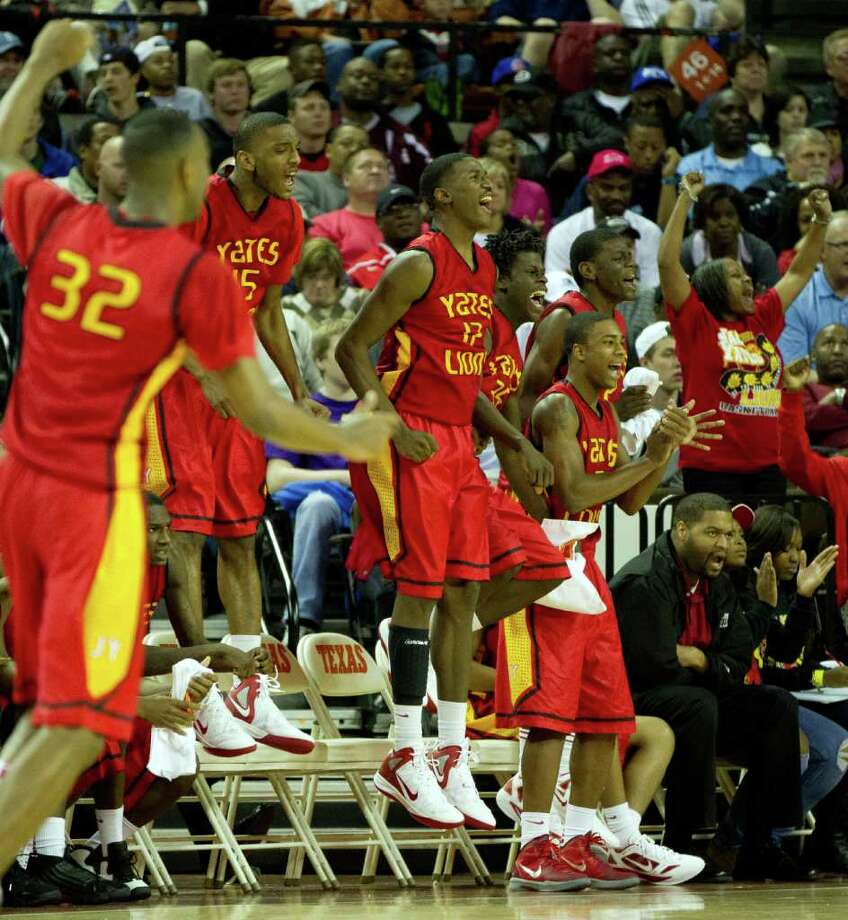 Houston Yates players celebrate a basket by Damyean Dotson during the second half of the UIL class 4A state championship high school basketball game at the Erwin Center on Saturday, March 10, 2012, in Austin.  Kimball won the game 78-75. Photo: Smiley N. Pool, Houston Chronicle / © 2012  Houston Chronicle