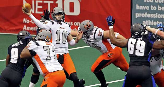 Blaze quarterback Tommy Grady throws out of a crowd as the San Antonio Talons beat the Utah Blaze 54-48 at the Alamodome  on March 10, 2012 Tom Reel/ San Antonio Express-News Photo: TOM REEL, Express-News / San Antonio Express-News
