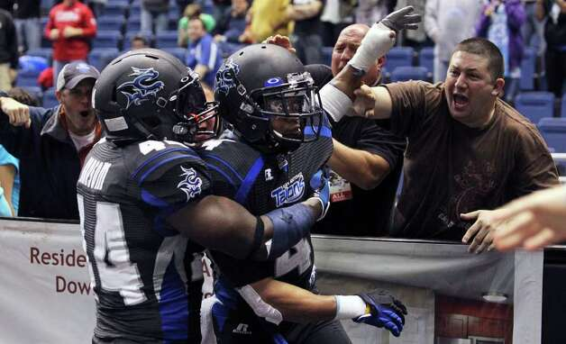 Fans congratulate Kenneth Fontenette after he stopped a touchdown pass in the final seconds as the San Antonio Talons beat the Utah Blaze 54-48 at the Alamodome  on March 10, 2012 Tom Reel/ San Antonio Express-News Photo: TOM REEL, Express-News / San Antonio Express-News