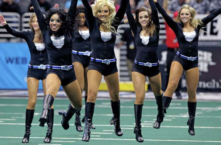 The Talons Sky Dancers jump in a routine as the San Antonio Talons beat the Utah Blaze 54-48 at the Alamodome on March 10, 2012 Tom Reel/ San Antonio Express-News