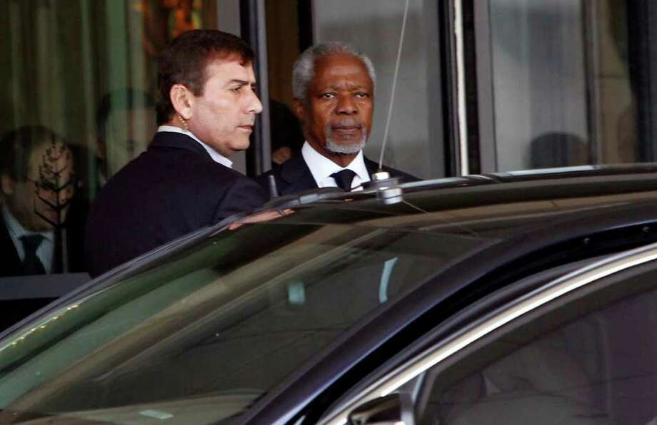 Kofi Annan, the United Nations special envoy to Syria, center, leaves the Four Seasons Hotel in Damascus, Syria, Saturday, March10, 2012 on his way to the presidential palace for a meeting with Syrian President Bashar Assad. U.N. envoy Kofi Annan arrived in Syria on Saturday to push for an end to the country's yearlong conflict and deliver a message to Syrian President Bashar Assad that all violence must stop. (AP Photo/ Bassem Tellawi) Photo: Bassem Tellawi / AP