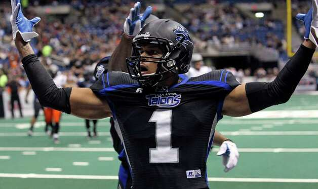 Carl Moore celebrates a third quarter touchdown as the San Antonio Talons beat the Utah Blaze 54-48 at the Alamodome  on March 10, 2012 Tom Reel/ San Antonio Express-News Photo: TOM REEL, Express-News / San Antonio Express-News