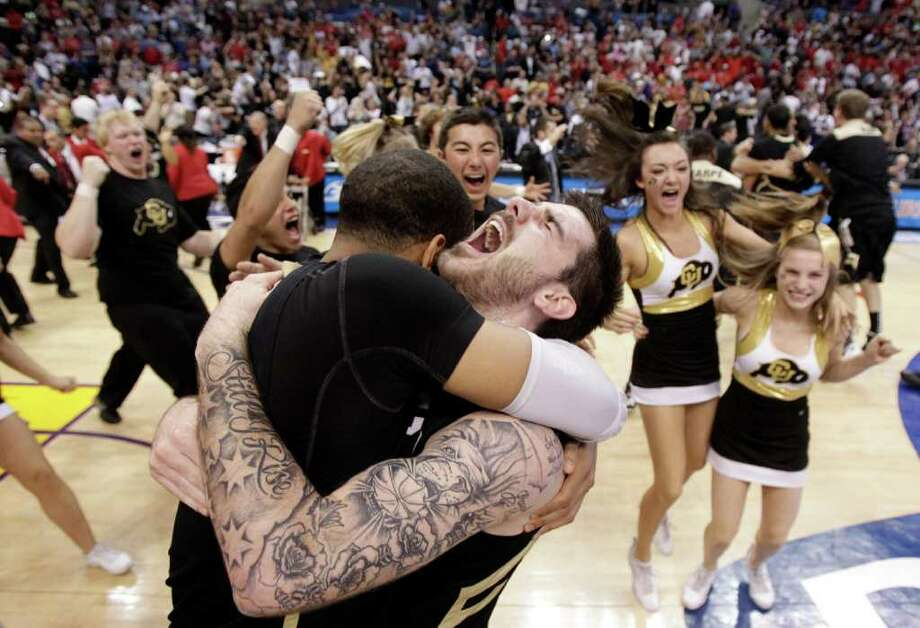 Colorado's Nate Tomlinson (right) and teammate Carlon Brown embrace after the sixth-seeded Buffaloes secured an NCAA tournament bid for the first time since 2003. Photo: AP