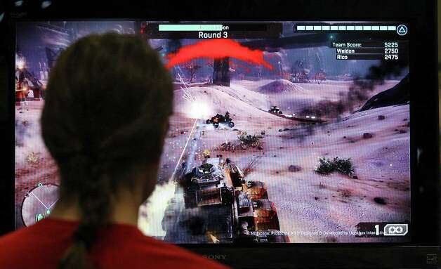 "FOR METRO - Jimmy Brisson, 21, plays the video game ""Starhawk"" at the Palmer Events Center during South by Southwest Saturday March 10,  2012  in Austin, TX. Photo: EDWARD A. ORNELAS, SAN ANTONIO EXPRESS-NEWS / © SAN ANTONIO EXPRESS-NEWS (NFS)"