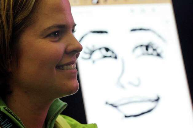 FOR METRO - Jessica Sanderson poses for a caricature drawn on a Samsung Galaxy Note by artist Jeff Ragsdale (not pictured) during South by Southwest Friday March 9,  2012 at the Austin Convention Center in Austin, TX. Photo: EDWARD A. ORNELAS, SAN ANTONIO EXPRESS-NEWS / © SAN ANTONIO EXPRESS-NEWS (NFS)