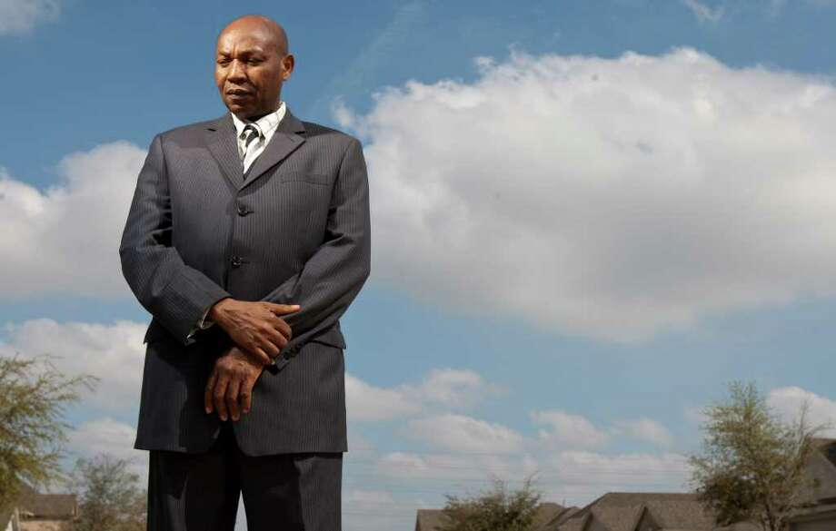 Olufemi Awolowo, a Sugar Land pastor and private security guard, says that after a 2010 accident caused by a sheriff's deputy, the county refused to cover his damages and demanded $10,649 to repair the deputy's car. Photo: Nick De La Torre / © 2012  Houston Chronicle