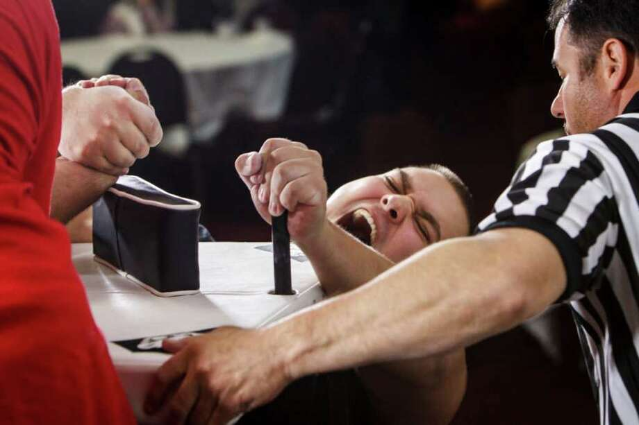 Josh Rivera competes during the Houston Armwrestling Association Armwrestling Tournament. Photo: Michael Paulsen, Houston Chronicle / © 2012 Houston Chronicle