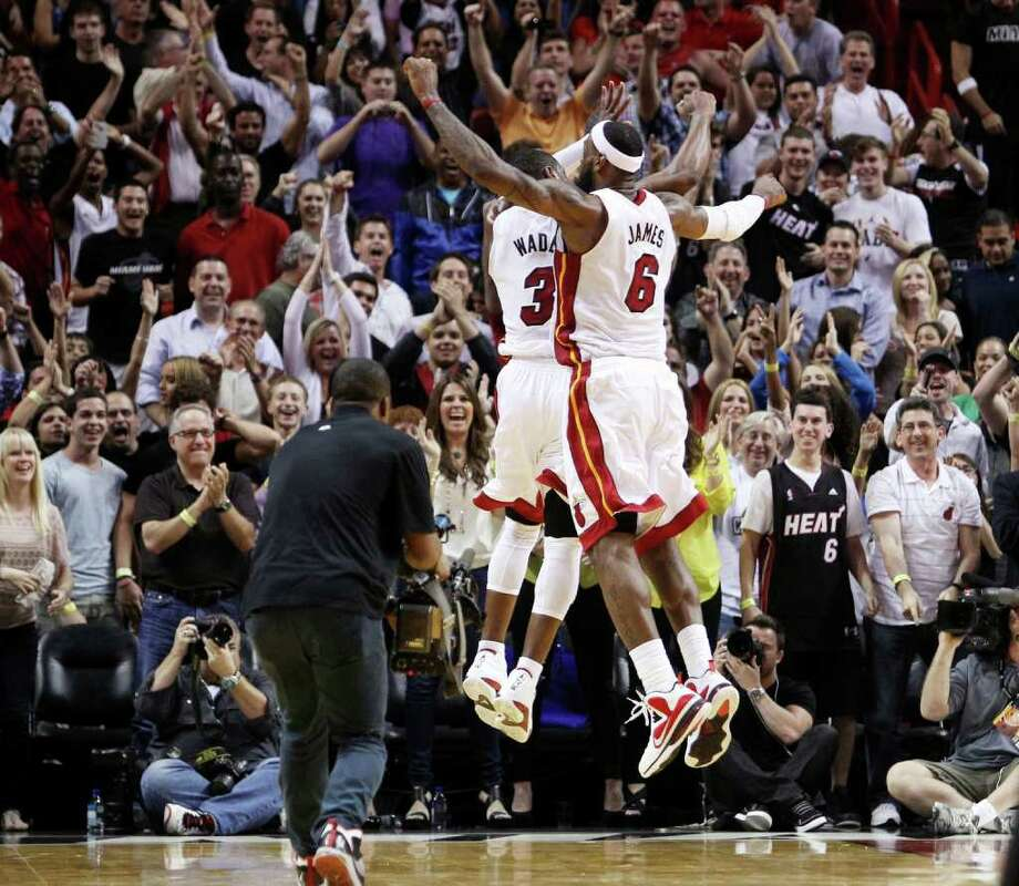 Dwyane Wade and LeBron James teamed up down the stretch to lift Miami past Indiana. Photo: AP
