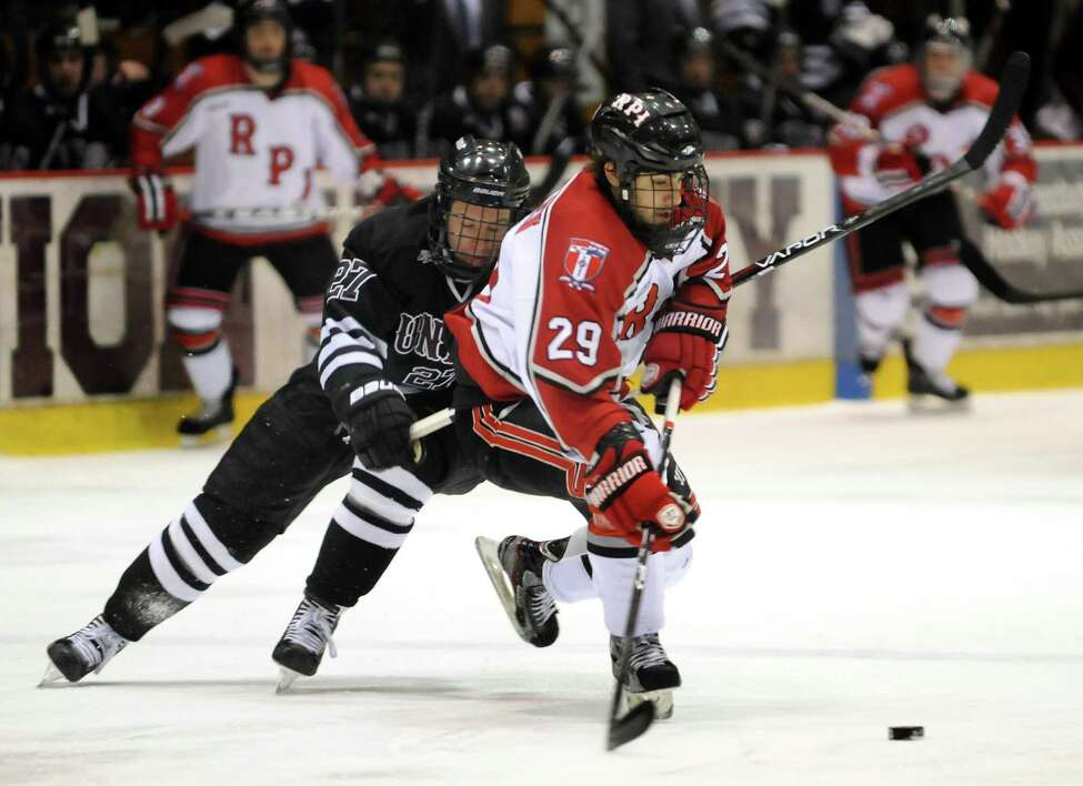 RPI's defenseman Nick Bailen, right, controls the puck as Union's Jeremy Welsh (27) pursues during Game 2 of the ECAC hockey quarterfinals on Saturday, March 10, 2012, at Union College in Schenectady, N.Y. (Cindy Schultz / Times Union)