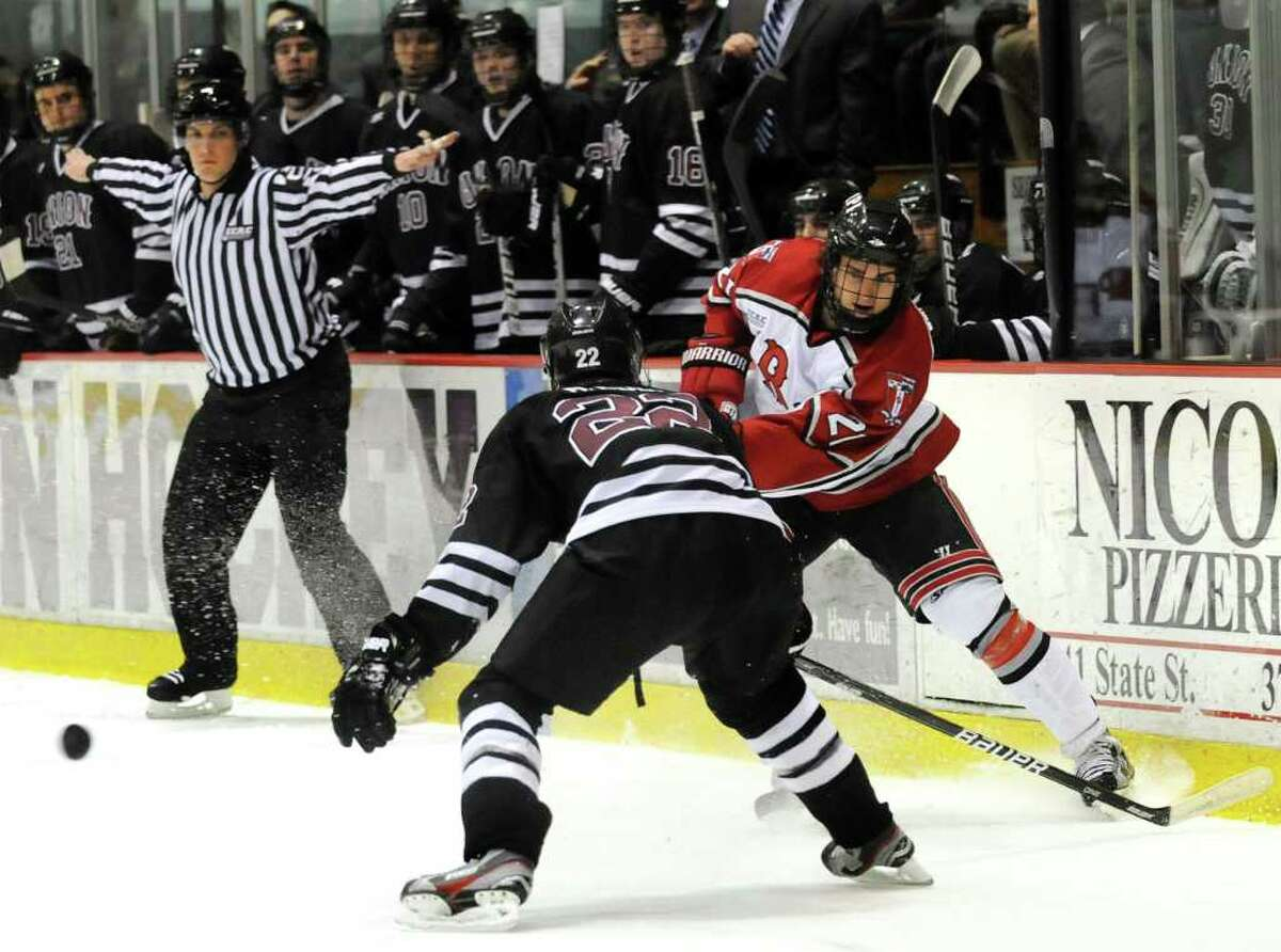 RPI's Mark McGowan (21), right, shoots the puck as Union's Mat Bodie (22) defends during Game 2 of the ECAC hockey quarterfinals on Saturday, March 10, 2012, at Union College in Schenectady, N.Y. (Cindy Schultz / Times Union)