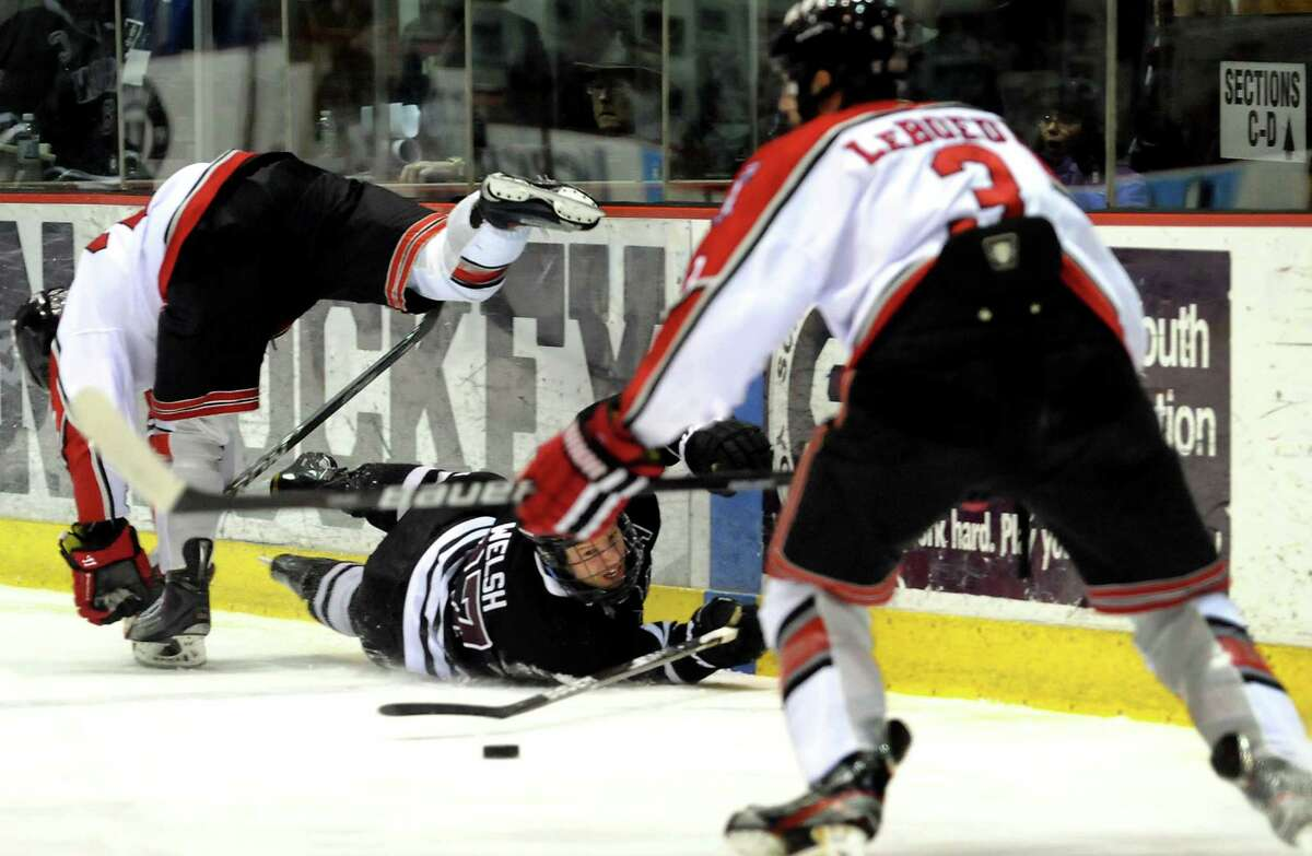 Union's Jeremy Welsh (27), center, and RPI's C.J. Lee (22), left, collide and RPI's Guy Leboeuf (3) chases the loose puck during Game 2 of the ECAC hockey quarterfinals on Saturday, March 10, 2012, at Union College in Schenectady, N.Y. (Cindy Schultz / Times Union)
