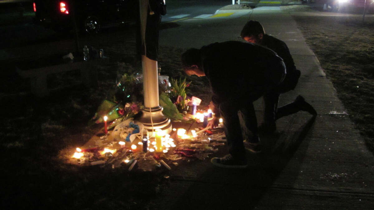 Students maintained a memorial at the base of the flagpole at Oxford High School Saturday night. Hundreds of them turned out for the all-day vigil for sophomore Brandon Giordano, killed in a car crash the night before. On Monday, grief counselors will be at the school to help them deal with the loss.